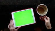 Tablet with Green Screen Laying on a Table