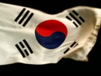 Taehanmin'guk country flag flying against black BG White w/ red blue yinyang symbol center different block trigrams from I Ching in each corner