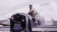 WS RAF tail gunner climbing aboard Lancaster bomber and cleaning canopy