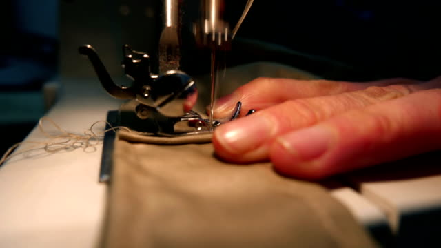 Tailor sewing on the sewing machine