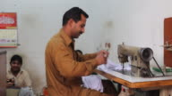 Tailor working with a sewing machine