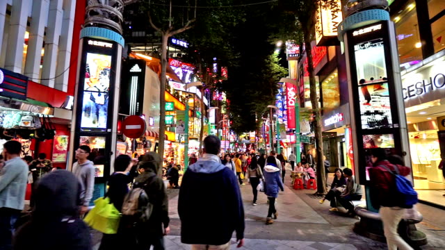 Taipei, China-Dec 1, 2015: Fast forward of young customers wander at Ximending shopping street, Taipei