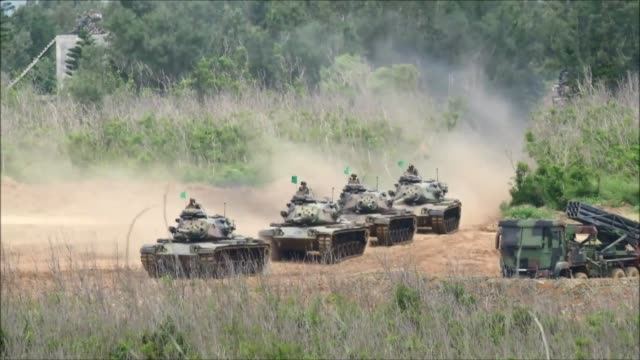 Taiwan forces simulate an invasion by China as part of live fire war games against a backdrop of rising tensions with Beijing