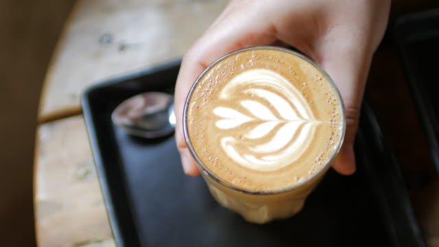 Take a break with coffee , coffee latte art at coffee shop