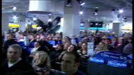 Take That appearance at HMV Oxford Street * * BEWARE High angle shot of crowd of fans screaming SOT / crowd of fans singing Take That song SOT /...