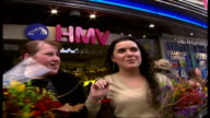 Take That appearance at HMV Oxford Street EXT Vox pops Two female fans who were first in the queue to get their CD album signed
