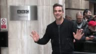 Take That group member Robbie Williams arrives at BBC Radio Two Studios to promote their upcoming tour Celebrity Sightings Take That at BBC Radio Two...