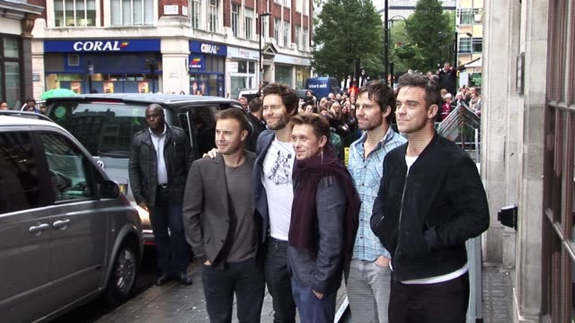 Take That meet their fans and awaiting news crews as part of their upcoming tour promotions Take That Visit Radio One at Radio One Studios on October...