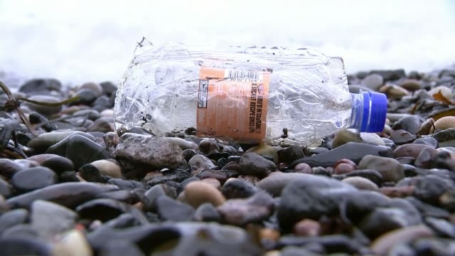 Takeaway plastic containers could be taxed T09021748 / TX Fife EXT Plastic bottle on shoreline Plastic wrap on shore of Firth of Forth with Forth...