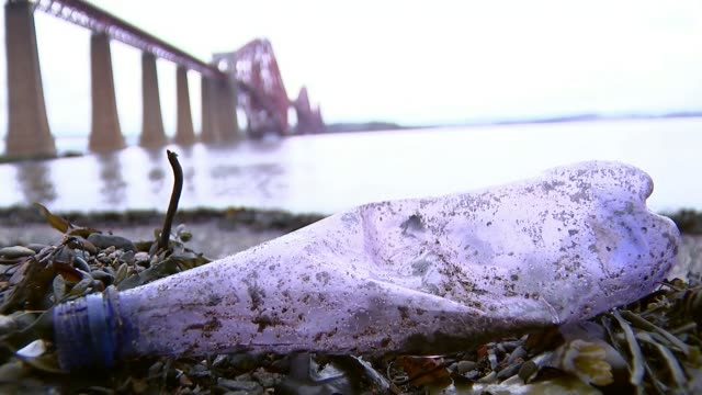 Takeaway plastic containers could be taxed T09021748 / TX Fife EXT Plastic bottle on shoreline of Firth of Forth with Forth Railway Bridge in...