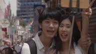 Takeshita Selfie Young Adult Selfie Slow motion Harajuku  Tokyo Japan.