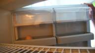 Taking last egg from fridge