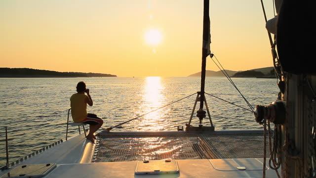 HD: Taking Photos While Sailing At Sunset