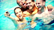 Taking selfies in swimming pool.