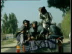 Taliban fighters on back of truck as escorting journalists to village allegedly destroyed by US bomb traveling through Jalalabad streets gunmen on...