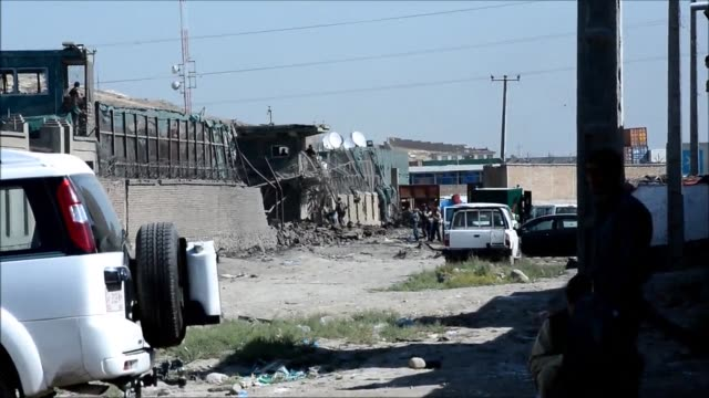 A Taliban truck bomb and gun attack kills seven people in the Afghan capital Kabul destroying the entrance to a NATO supply companys compound in the...