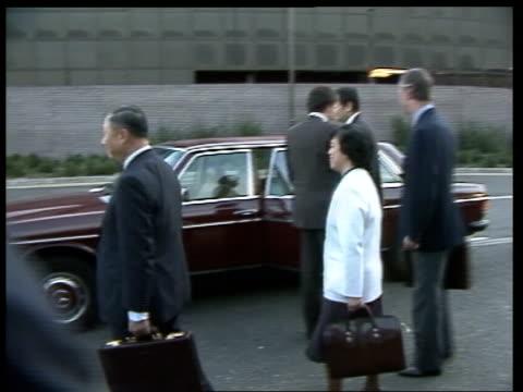 Talks with China continue ITN ENGLAND Gatwick MS Hong Kong Executive Councillors with Sir Edward Youde Governor of Hong Kong walk RL to car Whitehall...