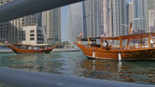 Tall buildings and harbour boats surrounding Dubai Marina, Dubai, United Arab Emirates, Middle East, Asia