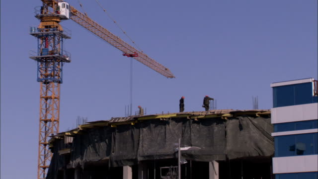 A tall crane stands near a construction site in Astana Kazakhstan. Available in HD.