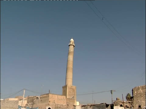A tall minaret towers above the streets of Mosul, Iraq.