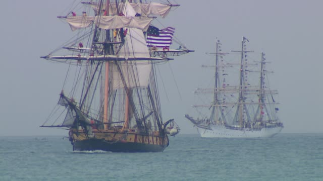 14 Tall Ships from all around the world docked at Navy Pier for the Tall Ships Festival 2 Tall Ships On Lake Michigan During Festival at Navy Pier on...