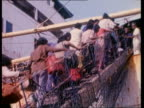 Tamil refugees boarding ship to move to north of island SRI LANKA Colombo EX GV Indian ship docked Tamils going up gang plank to ship / MS More...