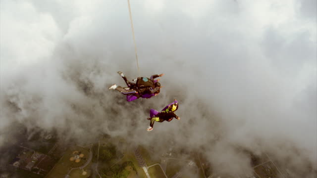 Tandem skydive next to beautiful clouds