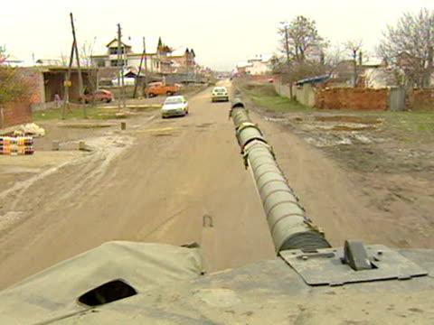 NATO tank patrols street Kosovo 1999