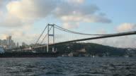 Tanker Passing Under The Bosphorus Bridge at Istanbul