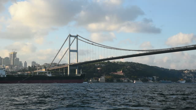 Tanker Passing Under The Bosphorus Bridge at Istanbul
