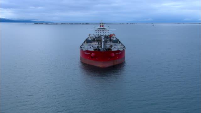 A tanker ship cruises off the coast of Alaska.