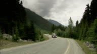 A tanker truck travels along a mountain road. Available in HD.