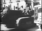Tanks and soldiers moving through streets of Italy / map illustrates attack on Germany's Gustav Line / General Alexander and General Mark Clark /...