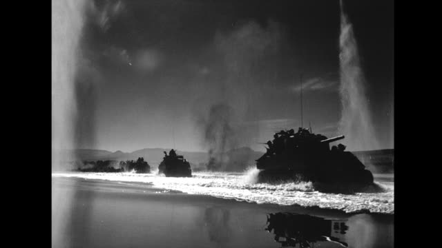 Tanks crossing river under fire which kicks up lots of water Tanks under fire on January 01 1945 in Unspecified