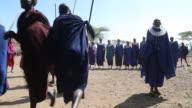 Tanzania, Ngorongoro conservation area (NCA),Masai men and women dancing and singing the welcome dance