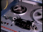 Tape recorder zoom in to spinning tape 1979