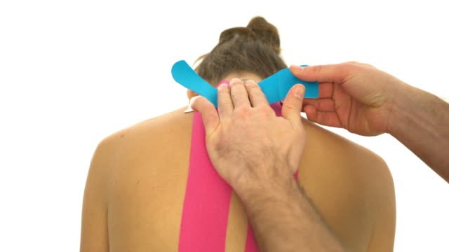 taping womans neck