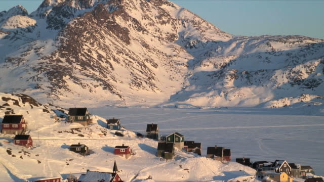 WS ZO HA Tasiilaq village surrounded with snow covered mountains, East Greenland