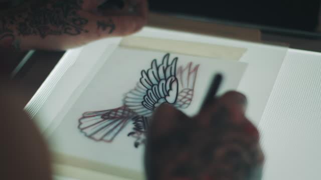 Tattoo artist drawing eagle