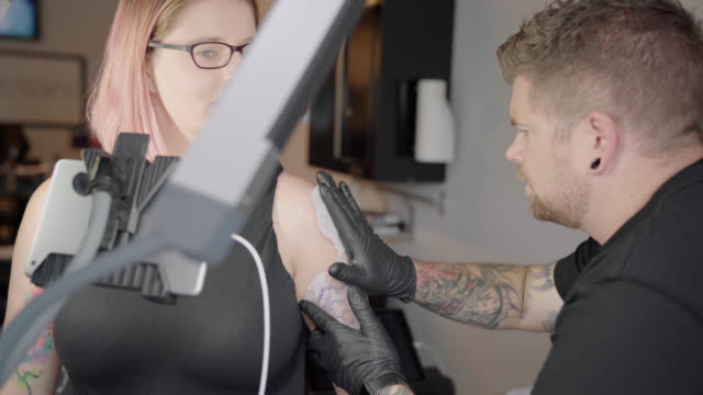 Tattoo Artist Stencils a Tattoo