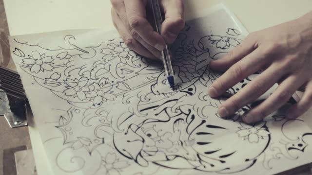 Tattoo master drawing process