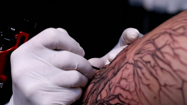 Tattooing a man
