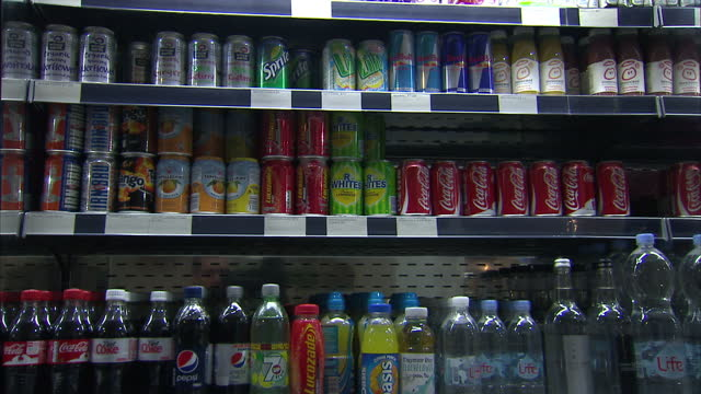 A tax on sugary drinks would reduce the number of obese adults in the UK by 180000 and raise over £275m for the Treasury according to doctors...