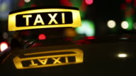 Taxi driving with motion blur and city lights