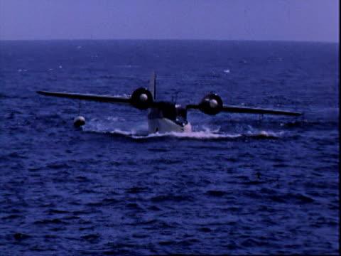 taxiing on ocean water 1955 twin engine propeller sea plane on May 14 1955 in Catalina Island California