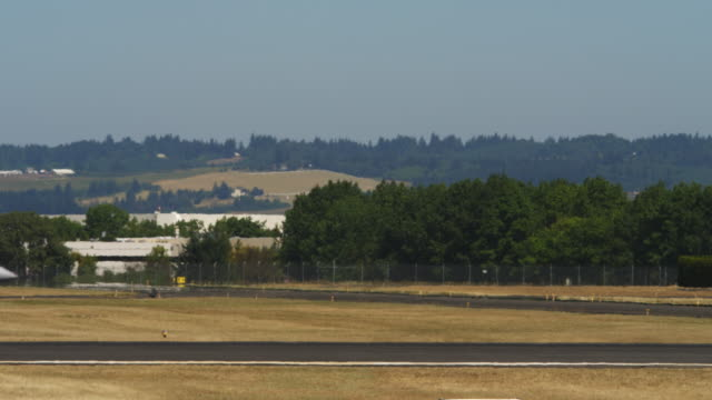 F-18 taxiing on tarmac with shimmering heat waves