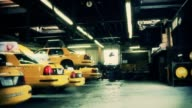 Taxis are parked in a garage.