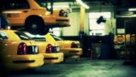 Taxis are stored in a garage in New York City.
