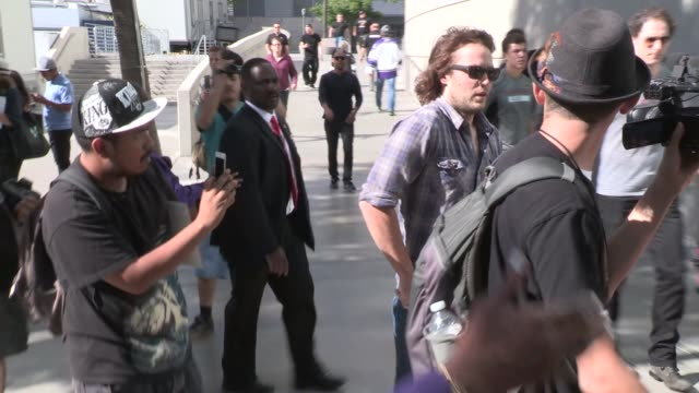 Taylor Kitsch greets fans while entering the LA Kings vs NY Rangers Game 5 Stanley Cup Finals at the Staples Center in Los Angeles Celebrity...