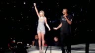 Taylor Swift gets presented a banner by Kobe Bryant at Staples Center in Los Angeles in Celebrity Sightings in Los Angeles